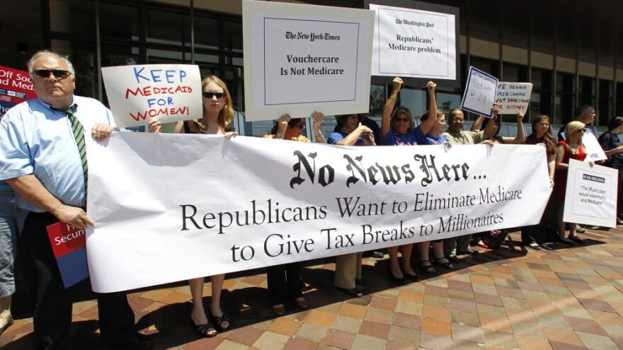 Dozens of Medicare advocates gather outside the Newseum in Washington, D.C., on Monday.