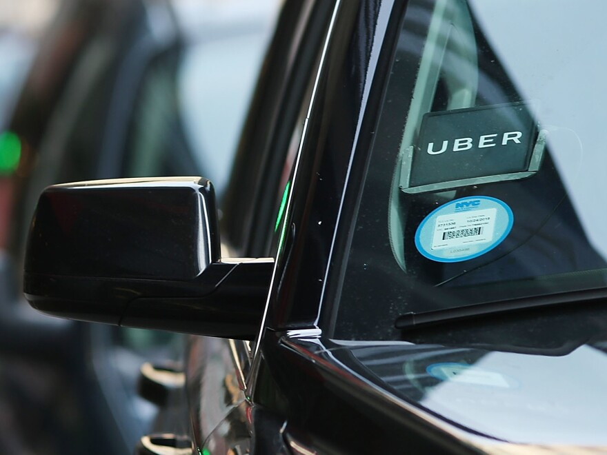 An Uber waits for a client in New York City. The company is partnering with health care organizations to provide patients with reliable transportation.