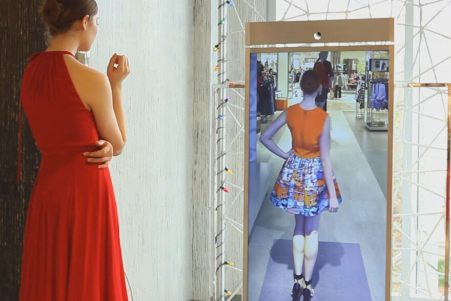 "Neiman Marcus is testing a digital ""Memory Mirror"" that uses video to let shoppers see how outfits they have tried on look from the back."