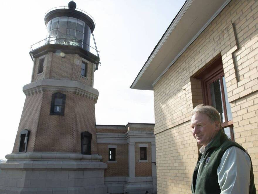 Lee Radzak looks over the Lake Superior at Split Rock Lighthouse located near Two Harbors, Minn. Radzak is retiring after 36 years as the longest-serving manager of the iconic Minnesota lighthouse.