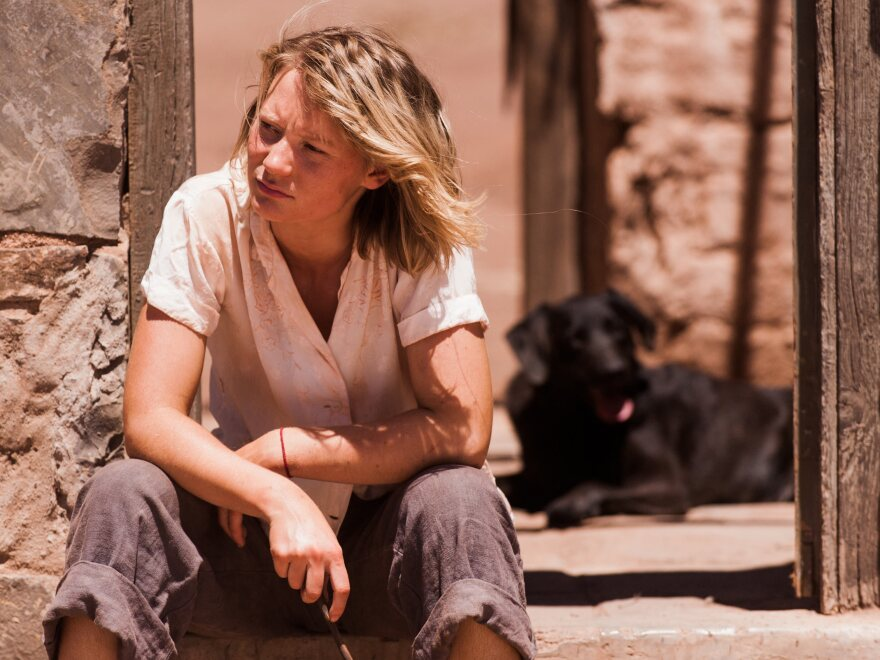 Mia Wasikowska plays Robyn Davidson, a woman whose real-life journey across the Australian desert is depicted in <em>Tracks</em>.