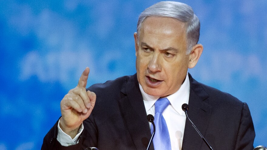 Israeli Prime Minister Benjamin Netanyahu gestures while addressing the 2015 American Israel Public Affairs Committee (AIPAC) Policy Conference in Washington, D.C. on Monday.