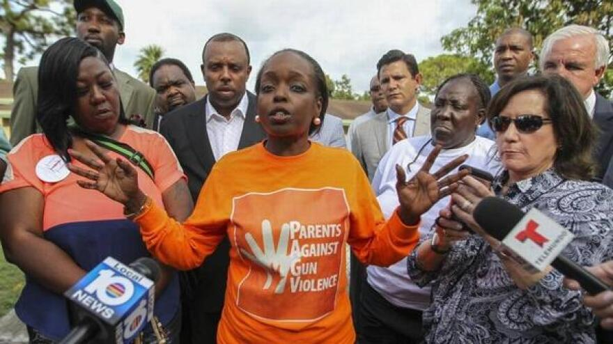 Community activist Tangela Sears addresses reporters during a news conference outside of a Northwest Miami-Dade home where an 8-year old girl was shot in August 2016.