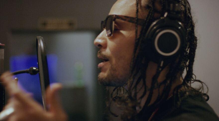 Bizzy Bone in the studio recording the album New Waves.
