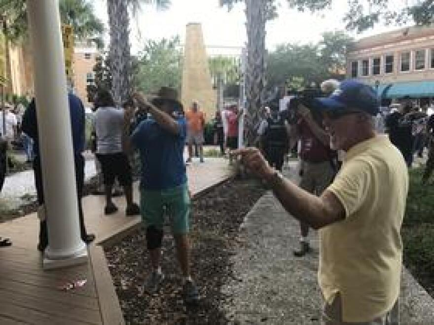 Bob Bolus pointing at people who want to take down the Confederate monument in front of the Manatee County courthouse. He wants the statue to stay because he says it's a part of history.