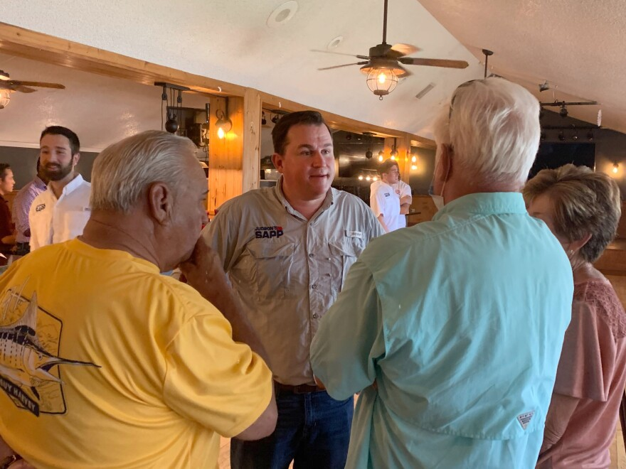Justin Sapp talks with potential voters