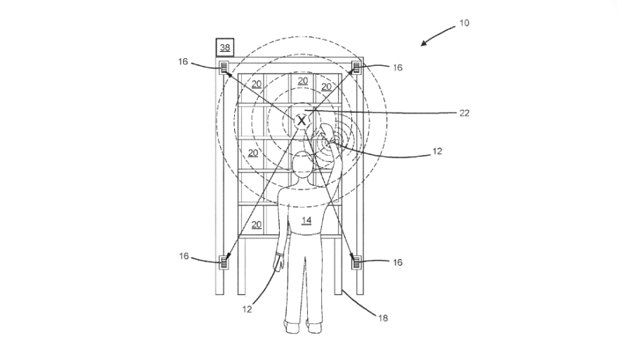 """A diagram from an Amazon patent application shows a human worker (labeled with """"14"""") wearing an ultrasonic bracelet tracking his or her hand movements and providing feedback. The patent was granted on Tuesday."""