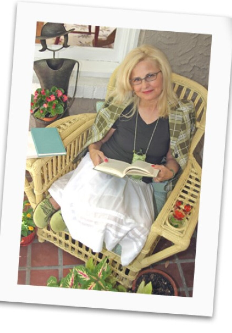 a picture of author Suzanne Beecher reading in a wicker chair