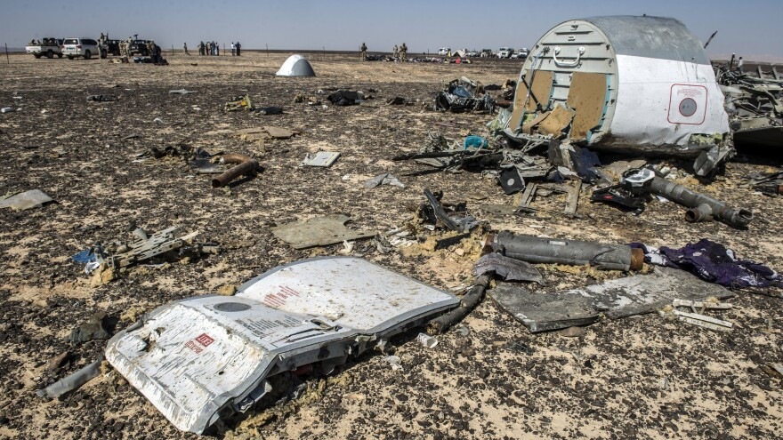 Debris from a Russian airliner can be seen at the site of the crash in a mountainous area in Egypt's Sinai Peninsula. Citing new information, Britain's government says it is concerned that a bomb might have brought the plane down.