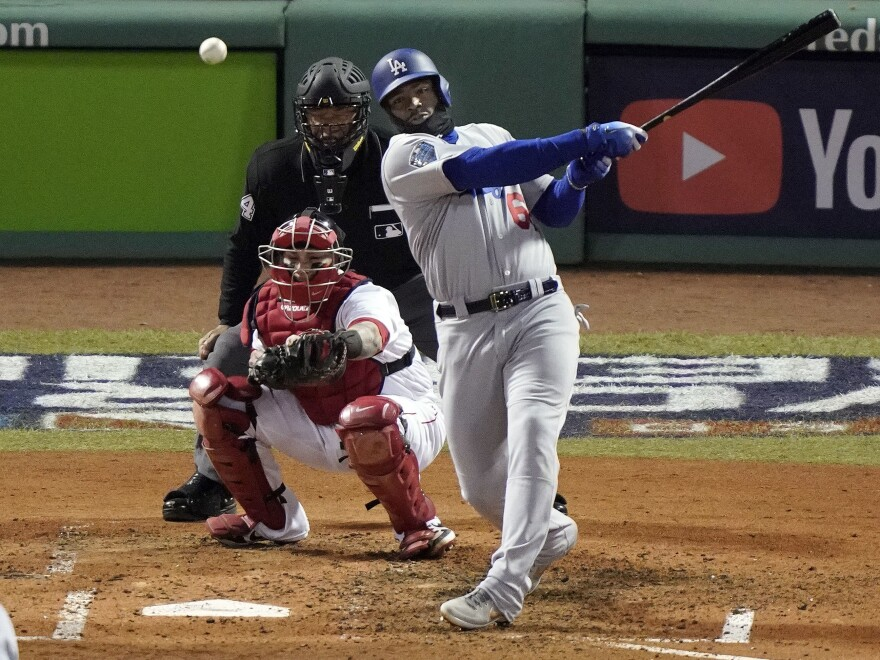 Los Angeles Dodgers' Yasiel Puig hits a single Wednesday night off Boston Red Sox starting pitcher David Price to drive in a run during the fourth inning of Game 2 of the World Series.