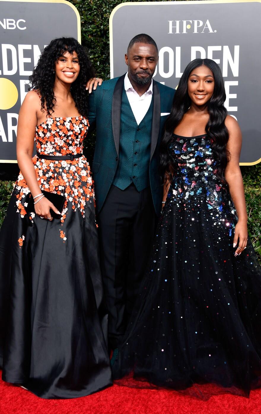 Left to right, Sabrina Dhowre, Idris Elba, and Isan Elba