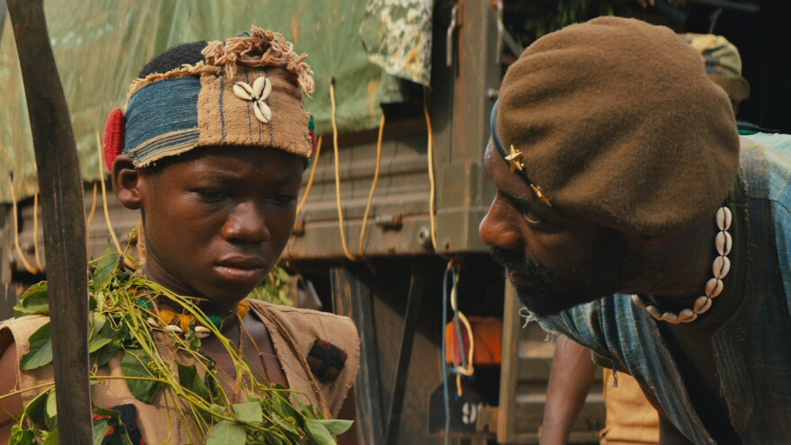Abraham Attah plays a child soldier and Idris Elba is his commander in Cary Fukunaga's <em>Beasts of No Nation.</em>