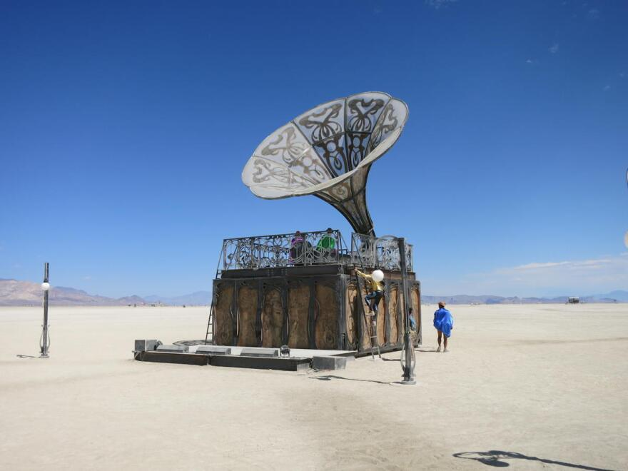 A sculpture made to look like a gramophone sits among other art installations built for Burning Man during the 2017 festival in the Black Rock Desert, Nev.
