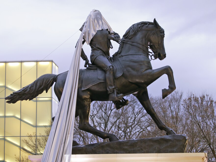 The drape got caught during the unveiling of Kehinde Wiley's statue <em>Rumors of War</em> at the Virginia Museum of Fine Arts in Richmond, Va., on Tuesday.