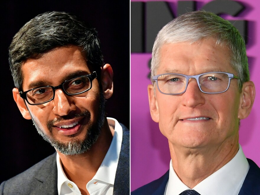 The Justice Department says Google CEO Sundar Pichai (left) met privately with Apple chief Tim Cook in 2018 to discuss how their two companies could collaborate.