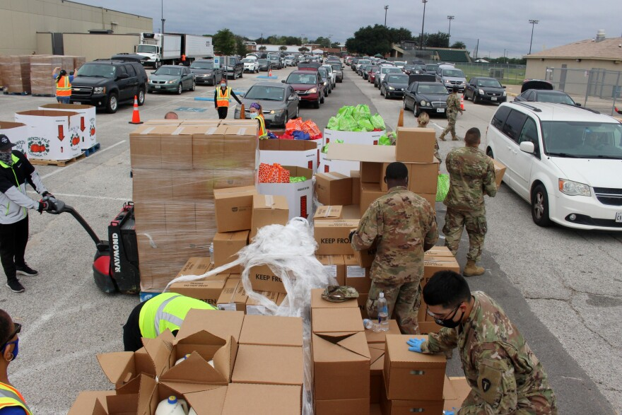Tarrant Area Food Bank workers hand out groceries at Herman Clark Stadium in Fort Worth on Friday, September 11, 2020.