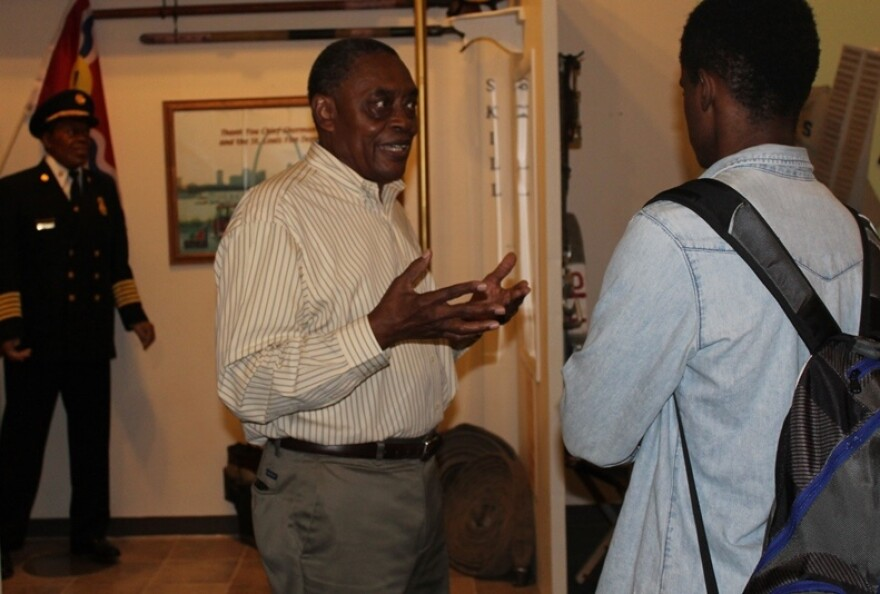 St. Louis' first African American fire chief Sherman George talks with a student from a Science Center program as his wax figure looks on. George was once expelled from high school for fighting. He told the group that whatever they did yesterday they shou