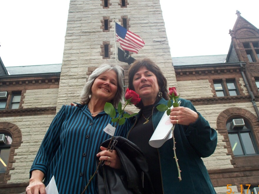 Tanya McCloskey (left) and Marcia Kadish with their marriage certificate outside city hall in Cambridge, Mass.