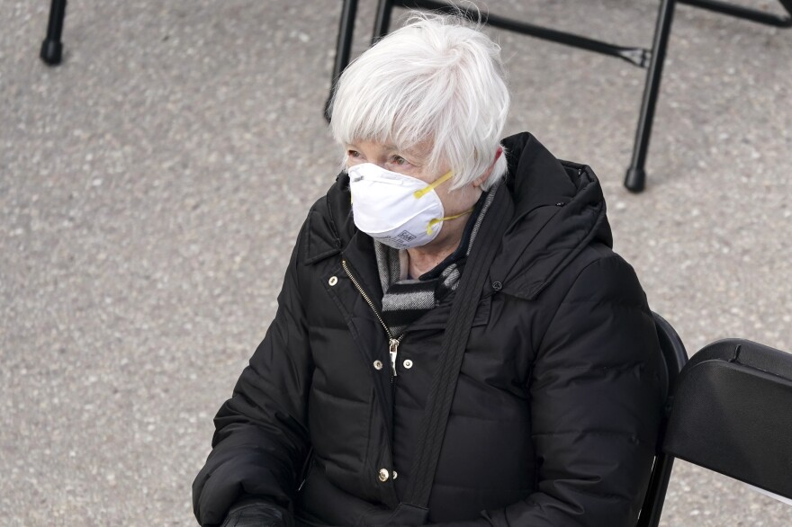 Janet Yellen, U.S. Treasury secretary nominee for President Biden, wears a disposable mask while attending the inauguration.