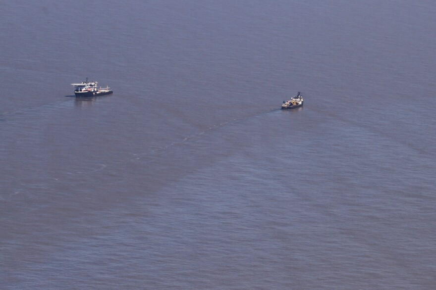 Contractors hired by the Coast Guard survey the Taylor Energy leak in March 2019.