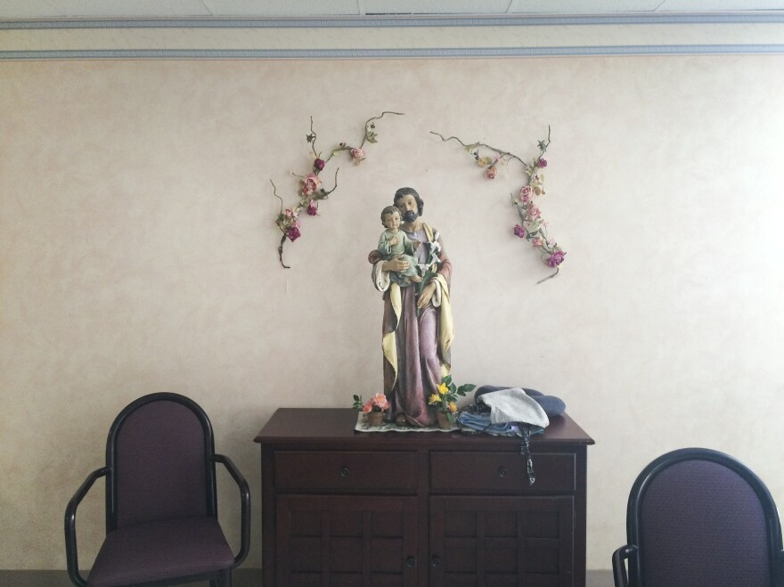 A statue of St. Joseph with baby Jesus Christ at the Little Sisters of the Poor, an order of Catholic nuns that runs homes for the elderly poor. The organization, along with several others, argues that the government's workaround to provide free birth control still burdens its free exercise of religion.
