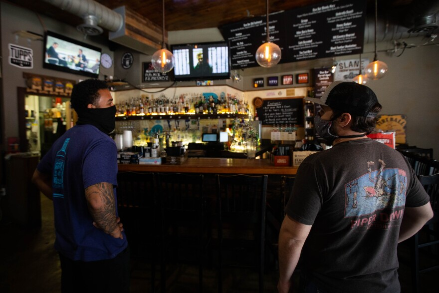 Bartenders Miles Mayfield and Glen Kurth at Dive Bar & Lounge in May.