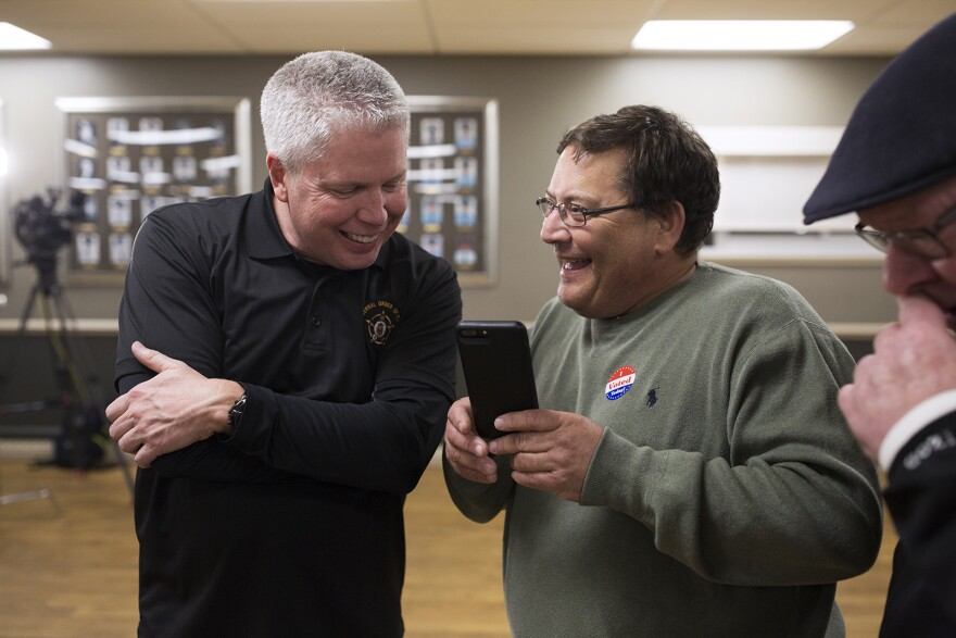 Jeff Roorda, the St. Louis Police Officers' Association's business manager, and Alderman Joe Vaccaro, receive the news that Prop P passed. Nov. 7, 2017