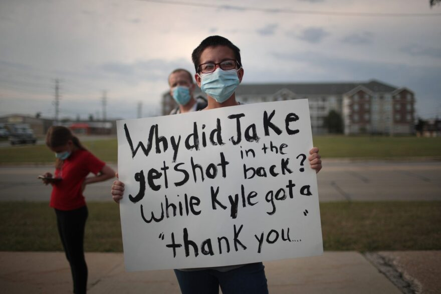 A small group of peaceful demonstrators protesting the shooting of Jacob Blake hold a rally in Kenosha, Wisconsin.
