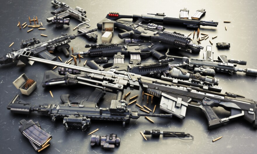 Weapons stash with automatic assault rifles and accessories,shotgun and sniper rifle. Consisting of bullet rounds, magazines,  front and rear sites, and a laser guided rifle scope.