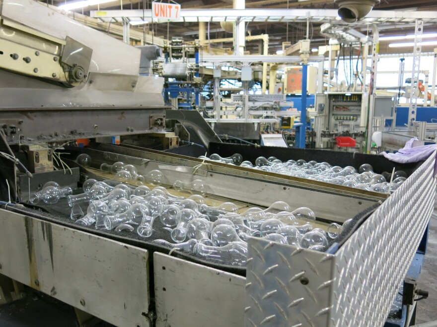 Parts of glass lightbulbs remain in the production lines. About 175 workers were affected when the plant shut down.
