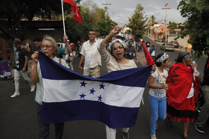 Members of the opposition to the administration of President Juan Orlando Hernandez march to protest the recent decision by the U.S. government to end temporary protected status, or TPS, for tens of thousands of Hondurans who have resided in the United States for nearly two decades, on the streets of Tegucigalpa, Honduras, Friday, May 4, 2018. (Fernando Antonio/AP)