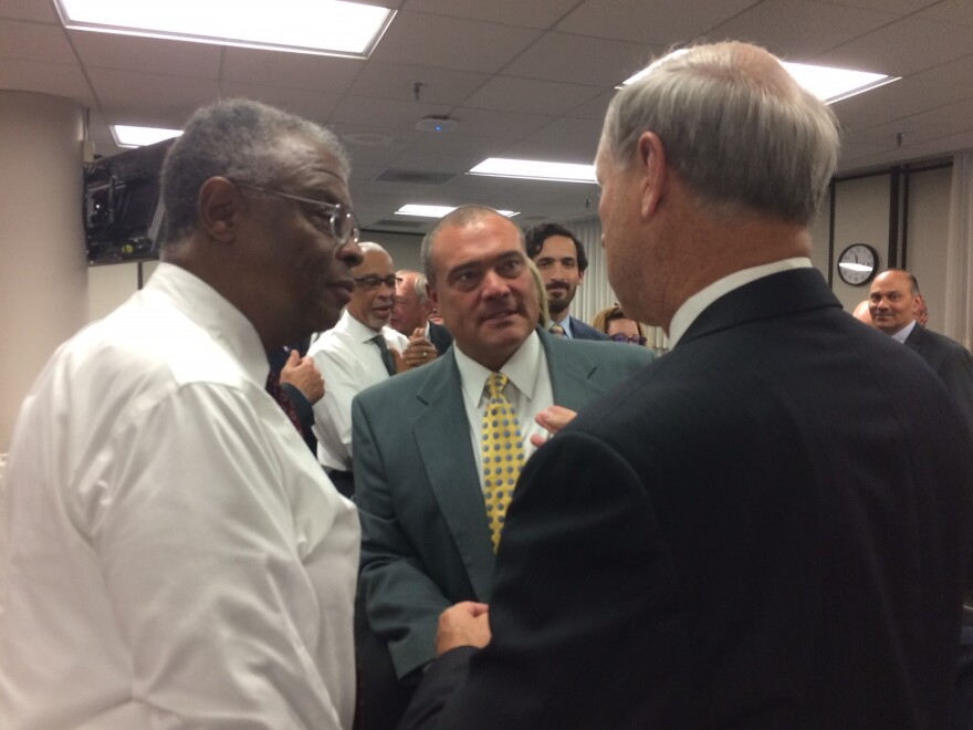 Riverview Gardens Superintendent Scott Spurgeon (center) talks with state board member John Martin (left) and deputy education commissioner Ron Lankford at the state school board meeting in October 2015.