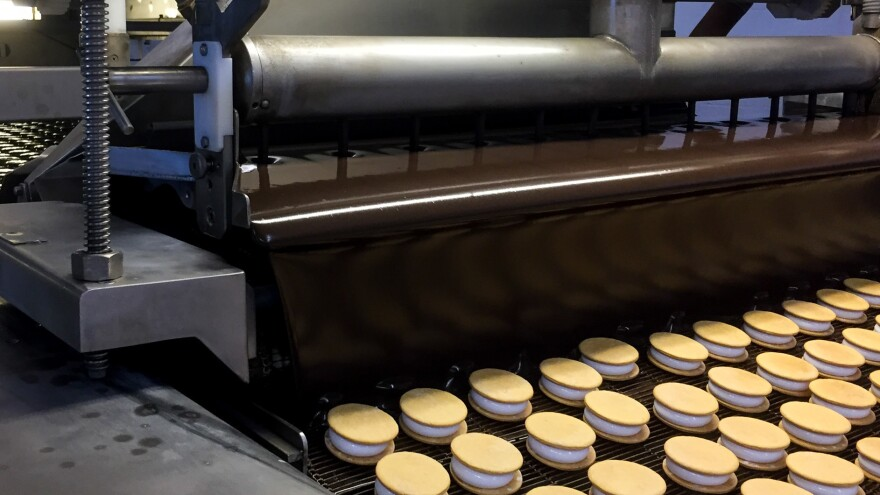 "A machine coined ""The Enrober"" provides the ""Willy Wonka moment"" of MoonPie-making, when the treats are propelled under a gooey chocolate waterfall."
