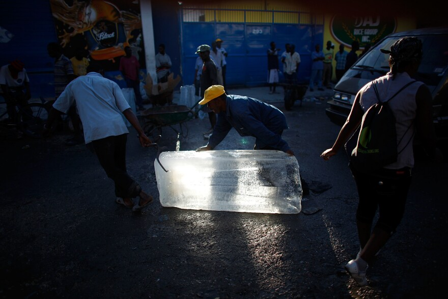 Men move blocks of ice to sell on the streets of Port-au-Prince. With the power still out, ice is the only way to cool and store any food.
