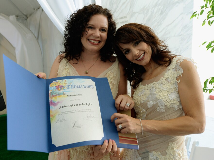 Sallee Taylor, left, and Andrea Taylor, hold their marriage certificate after they were married at on July 1, 2013 in West Hollywood, Calif.