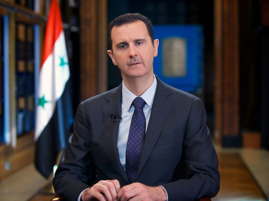 Syrian President Bashar Assad speaks during an interview on Wednesday.The U.S. is pushing for a resolution this week that would require Assad to dismantle his chemical weapons.