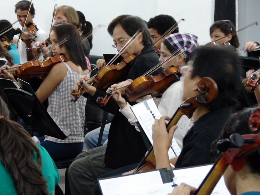 L.A. Philharmonic violinist SuLi Xue sits in with El Sistema students at the Simon Bolivar Conservatory in Caracas, Venezuela.