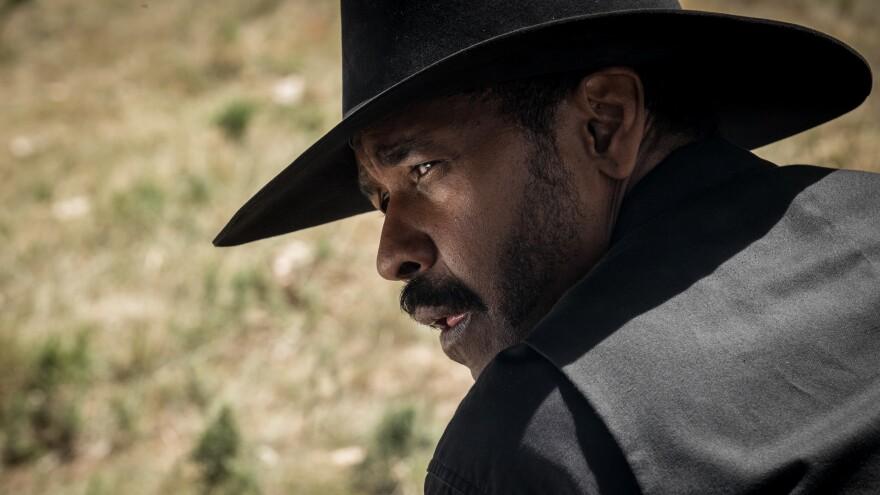 Denzel Washington stars in <em>The Magnificent Seven</em>.