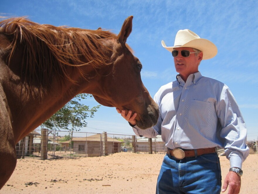 <p>George Hardeen, great-nephew of Harry Houdini, is seen in his corral in Tuba City, Ariz. He was a journalist, a horse trainer, and a spokesman for the former president of the Navajo Nation. Today, he does public relations and still rides horses.</p>