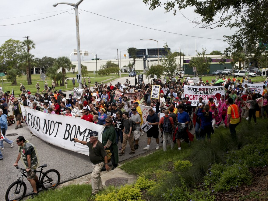Turnout for Monday's protest rally and march in downtown Tampa was much lower than expected and rain drenched the crowd.