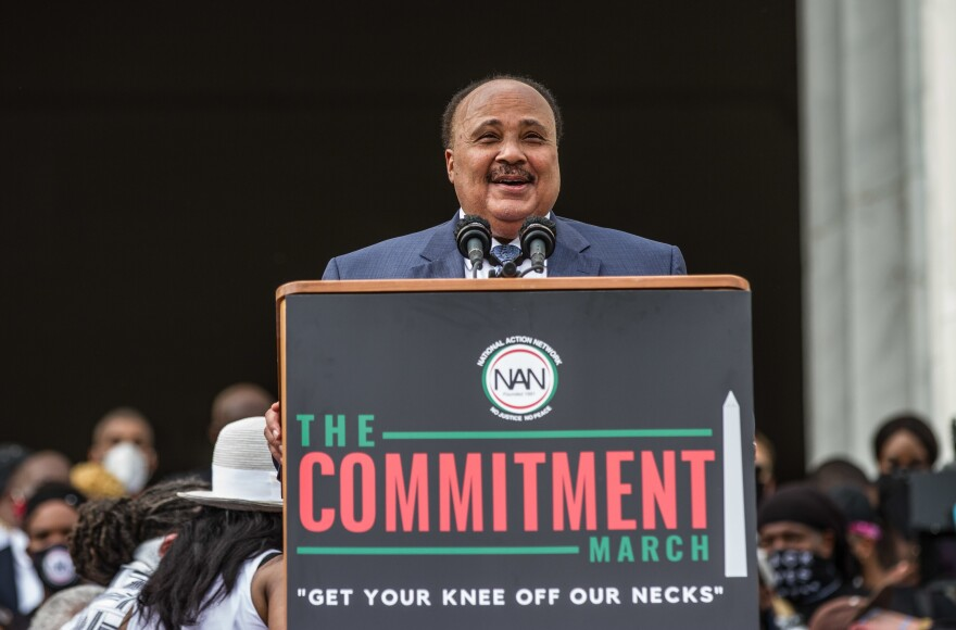 "Martin Luther King III, center at bottom, speaks Friday at the Lincoln Memorial during the event dubbed ""Get Your Knee Off Our Necks"" in Washington."