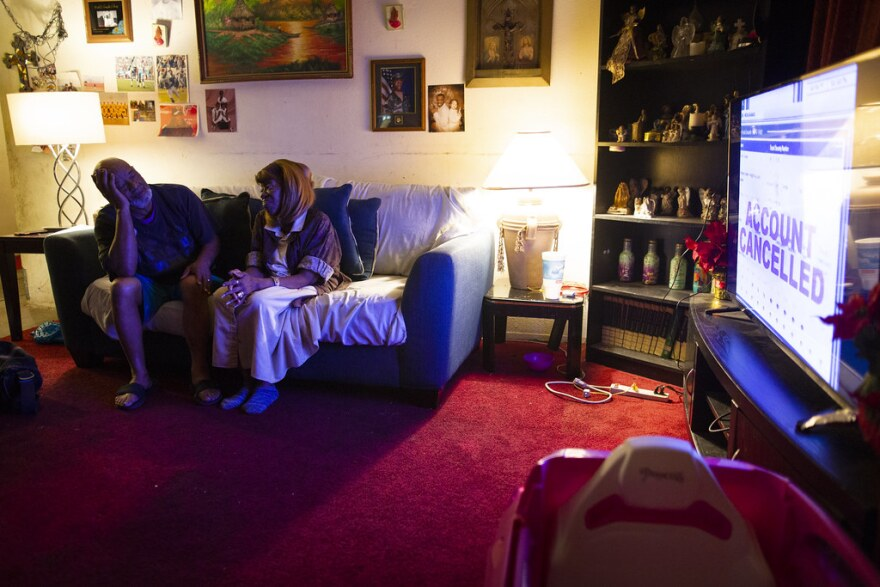 Willie and Earlene Williams sit on the couch in their living room.