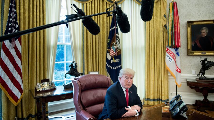 President Trump speaks to the media from the Oval Office on Dec. 22, 2017.