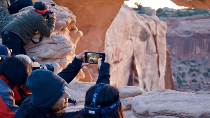 Around 50 tourists and photographers were huddled near Mesa Arch in Utah to catch a glimpse of the sunrise in early May.