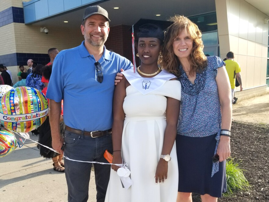 Aline Umwamikazi, on the day she graduated from Belmont High School. She's pictured here with her friend Jamie Cason and Jamie's husband.