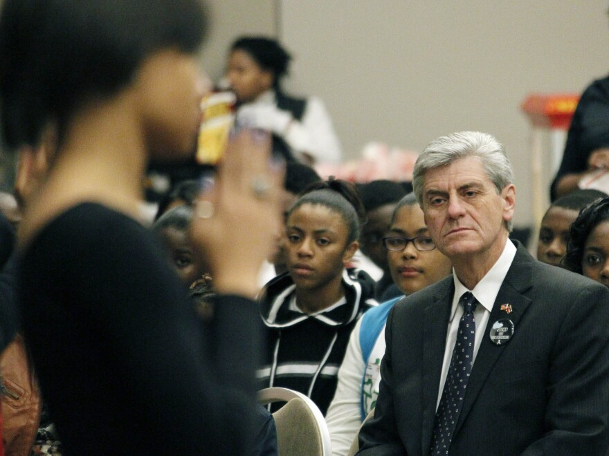 Gov. Phil Bryant, at the Teenage Pregnancy Prevention Summit in Jackson, Miss., in 2012, supports a controversial effort to identify men who impregnate teen girls.