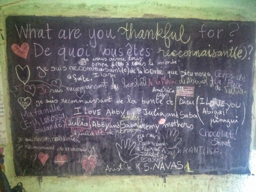 """Guests at Abby Reilly's Thanksgiving feast in Benin wrote what they're thankful for on her living room blackboard — including """"chocolat."""""""