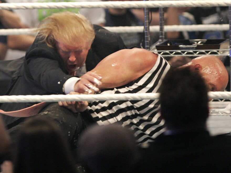 Donald Trump wrestling with 'Stone Cold' Steve Austin after the the Battle of the Billionaires at the 2007 World Wrestling Entertainment's Wrestlemania April 1, 2007.