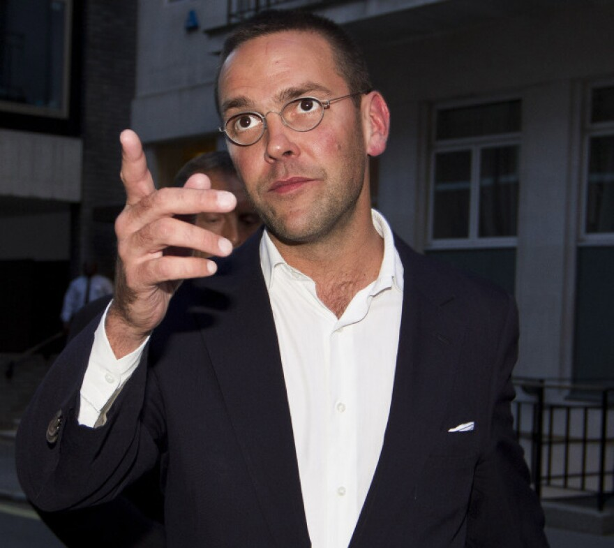 James Murdoch gesturing as he leaves his father Rupert Murdoch's residence in central London in July.