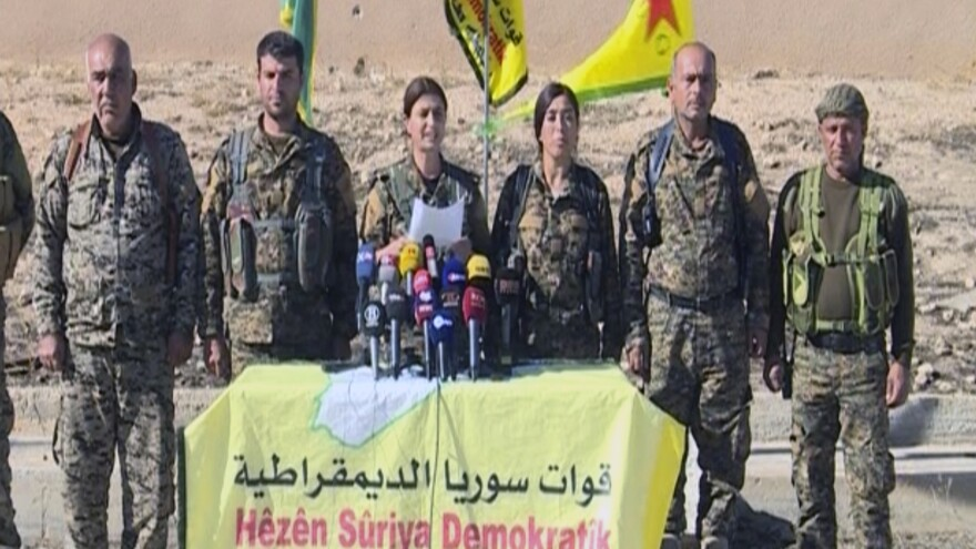 "Commanders of the U.S.-backed Syria Democratic Forces announce a campaign targeting ""obscurantists"" — ISIS — that have claimed Raqqa as their capital. This image comes from a frame grab from the Arab 24 network."